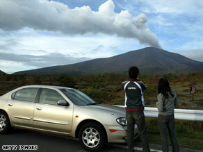 Motorists stop to watch Mount Asama erupt