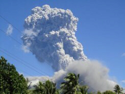 Mount Bulusan volcano emits ash into the air as it erupts