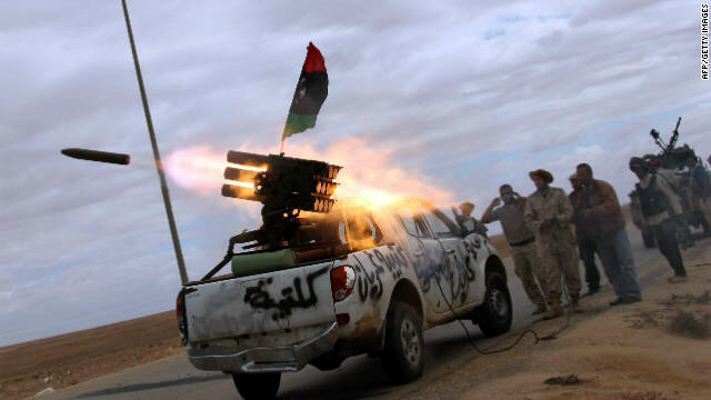 NTC fighters launch a rocket toward the desert city of Bani Walid