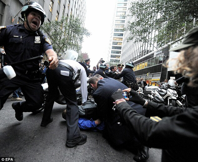 New York police officers arrest people participating in the Occupy Wall Street protest