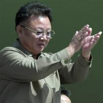 North Korean leader Kim Jong Il claps from balcony