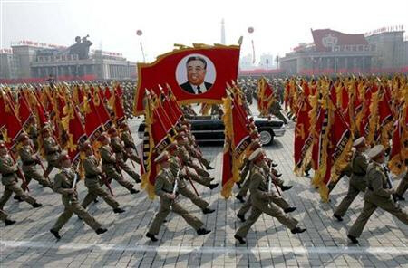 North Korea's military personnel parade with image of late Kim Il-Sung