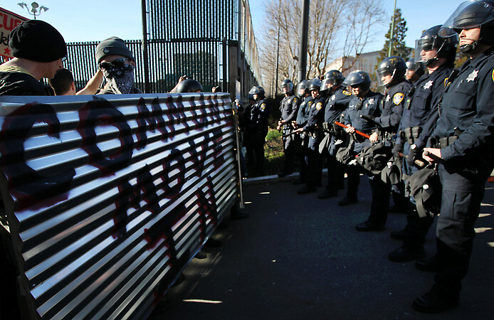 Occupy Oakland protesters are met with an Oakland police line