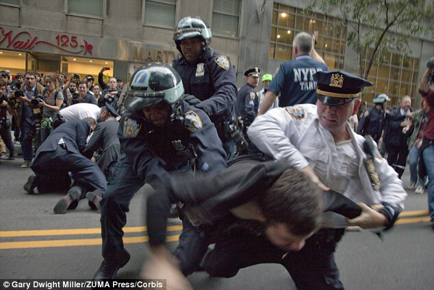 Occupy Wall Street protesters are arrested during a march in lower Manhattan, New York