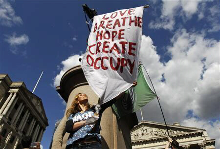 Occupy demonstrator protests outside Bank of England May 12, 2012