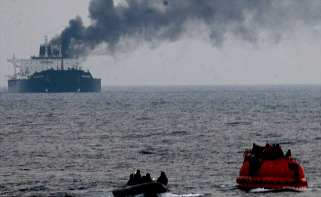 Crew members escape oil tanker attacked by Iranian fighter bombers