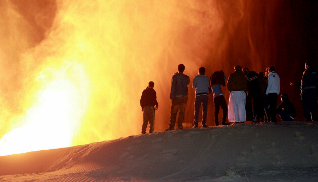 Onlookers watch fireball from attack on gas pipeline in northern Sinai