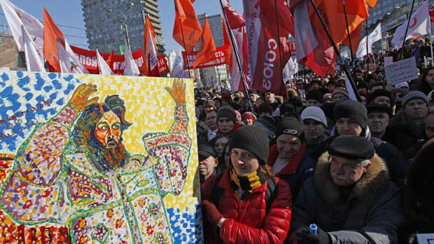 Opposition protesters with placard depicting Czar Ivan the Terrible