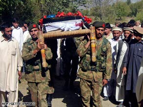 Pakistani soldiers carry the body of a soldier