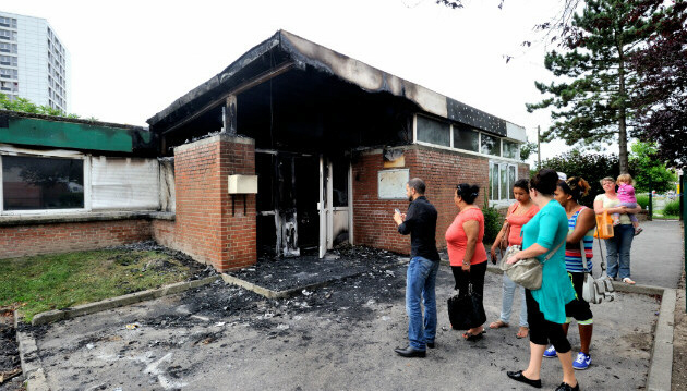 People look at damaged primary school in Amiens, northern France