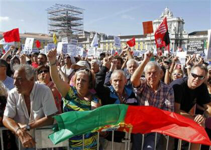 People shout slogans during a protest in Lisbon