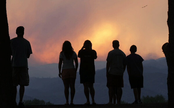 People watch giant smoke plume rise from Waldo Canyon Fire