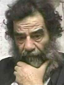Photograph of Saddam Hussein after his capture