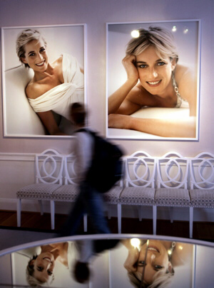 visitor views pictures, reflected in a mirrored surface, of late Princess Diana, made by photographer Mario Testino, at Kensington Palace in central London, Friday June 29, 2007.