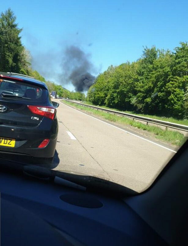 Plane crashes into highway in Wales
