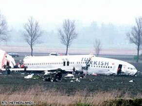 Images from the scene of the Amsterdam crash show the plane broken into three pieces.