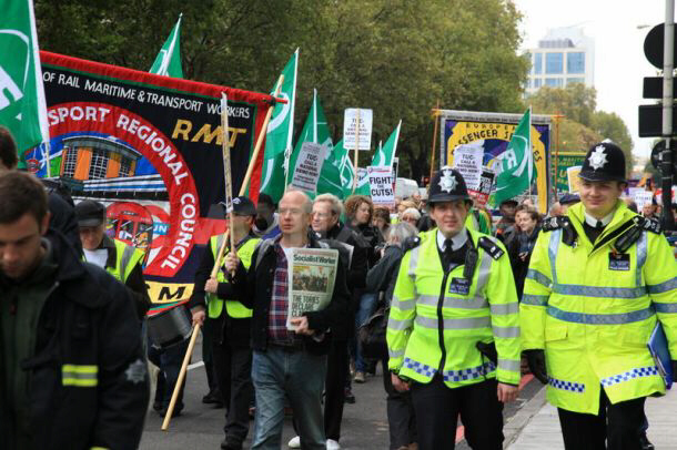 Police accompany protestors during RMT March Against the Cuts, London, 23rd October 2010