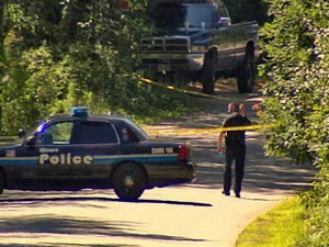 Police block off the road near home of Maher strangling