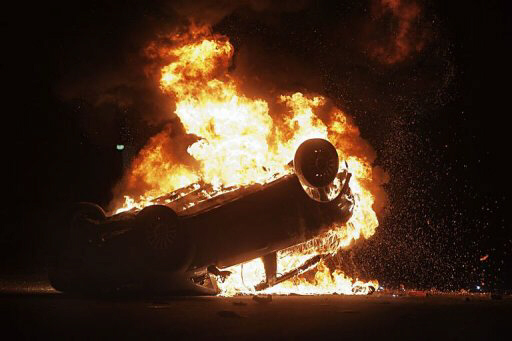 Police car is set fire by demonstrators after clashes in Terzigno