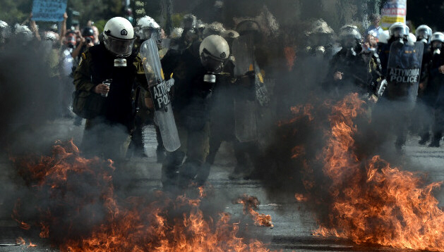 Police clash with demonstrators at anti-austerity rally in Athens