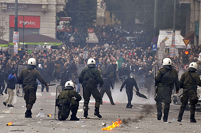 Police fire teargas at petrol bomb-throwing activists as strikes paralyse public services and transport in Athens