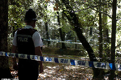 Police guard the woodland spot where Stephanie Parker's body was found