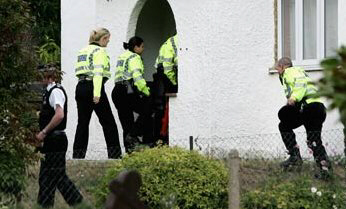Police raid a home in High Wycombe, near London