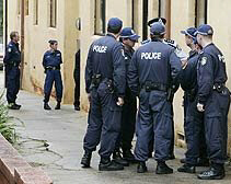 Police stand outside a Sydney apartment building