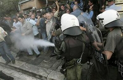 Police use tear gas to disperse workers
