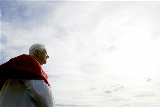 Pope Benedict XVI admires the sky above Sydney, Australia. The Vatican has hosted a dayslong conference to study the possibility of alien life in the universe and its implication for the Catholic Church. (AP Photo/Gregorio Borgia, file)