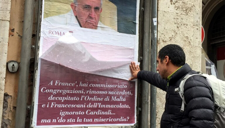 Pope Francis becoming an antipope say posters