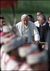Pope John Paul II is carried on a mobile platform upon his arrival in Bulgaria
