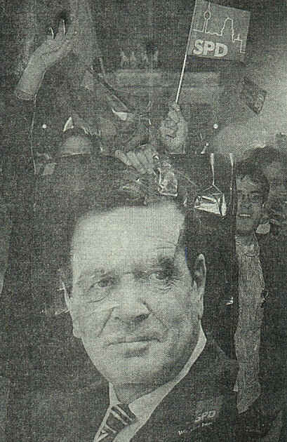 Poster of Gerhard Schroeder is held by supporters