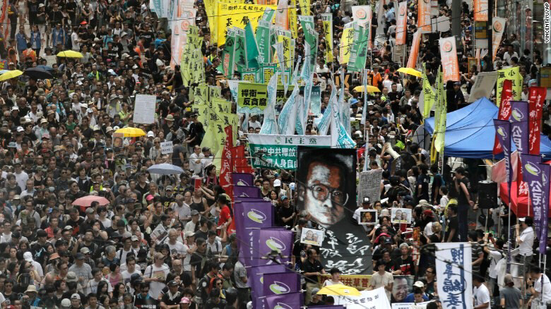 Protesters carry image of jailed Nobel Peace laureate Liu Xiaobo