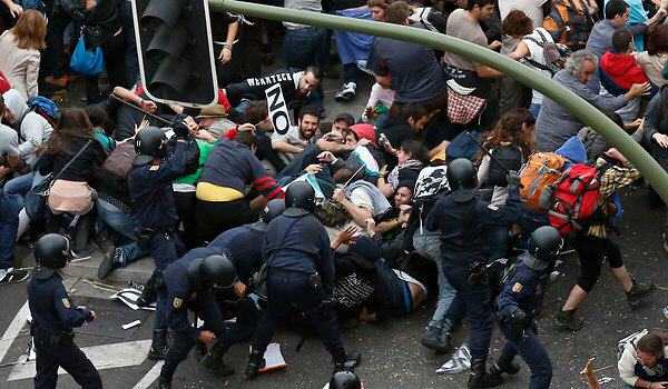 Protesters clash with riot police during demonstration in Madrid