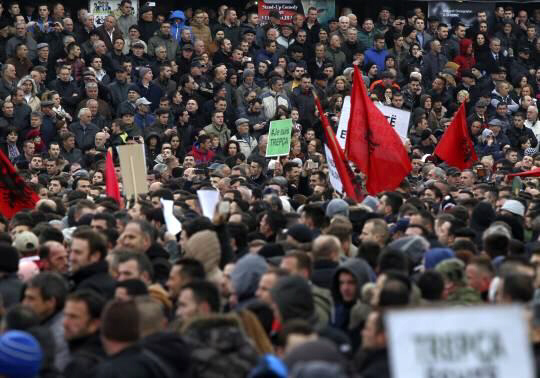 Protesters hold a demonstration in the centre of Pristina