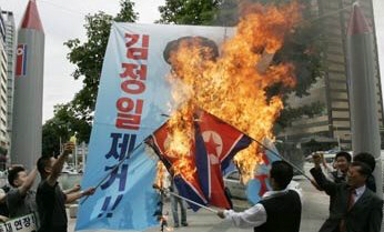 Protesters in Seoul burn North Korean flags and images of Kim Jong Il.