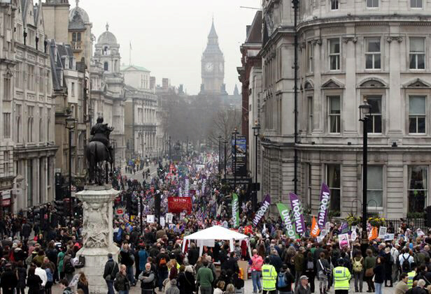 Protesters march down Whitehall in protest at government cuts