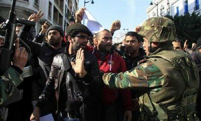 Protesters react to soldiers during demonstration in Tunis