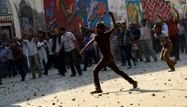 Protesters showered each other with stones in Cairo