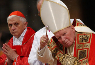 "Cardinal Ratzinger appears with a ""trembling"" Pope John Paul II during a Mass"