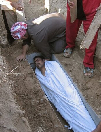 Relatives bury Raad Hammed, age 28 in Ramadi