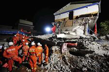 Rescue crews in China uncover dead, aid injured after Thursday's deadly earthquake