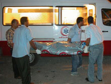 Rescuers carry a victim of the Sharm el-Sheikh terror attacks to an emergency vehicle