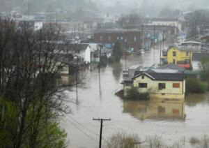 Residents used boats to paddle through some flooded towns