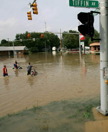Residents wade through a flooded intersection in Findlay, Ohio, on Wednesday.