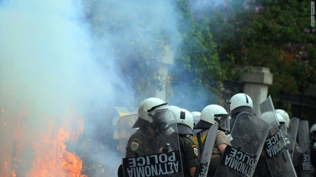 Greek riot police clash with protestors in the center of Athens on May 5.