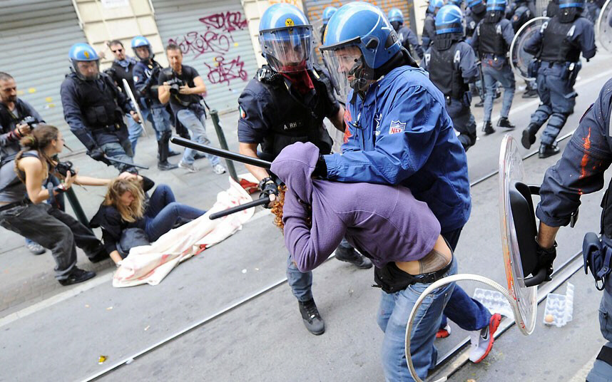 Riot police clash with female demonstrators during student protest in Turin