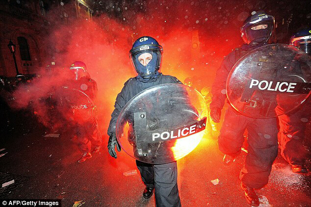 Riot police come under attack from flares