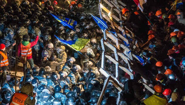 Riot police storm barricades set up by pro-European Union protesters